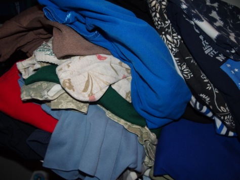 (This is embarrassing, but it's all for the sake of honesty. I yanked a T-shirt out of the pile and it toppled.)
